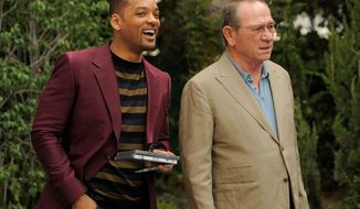 "Will Smith (left) and Tommy Lee Jones make a publicity appearance in Beverly Hills, Calif., for ""Men in Black 3."" They reprise their roles as government agents tracking aliens on Earth. (Associated Press)"