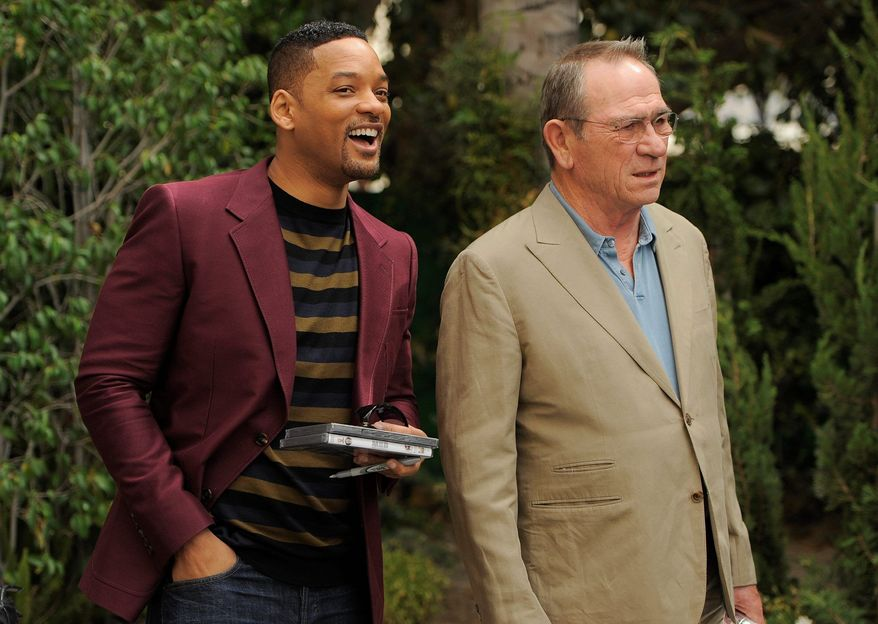"""Will Smith (left) and Tommy Lee Jones make a publicity appearance in Beverly Hills, Calif., for """"Men in Black 3."""" They reprise their roles as government agents tracking aliens on Earth. (Associated Press)"""