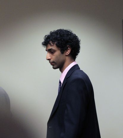 Dharun Ravi arrives May 21, 2012, at court in New Brunswick, N.J., for his sentencing hearing. Ravi, a former Rutgers University student who used a webcam to watch his roommate kiss another man days before the roommate killed himself, was sentenced to 30 days in jail and three years of probation. (Associated Press)