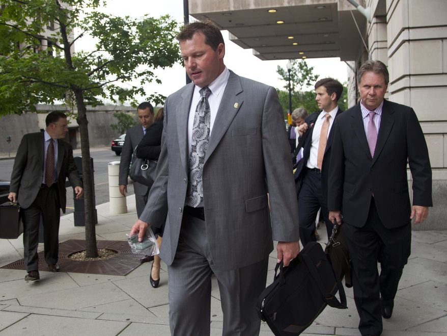 Former Major League Baseball pitcher Roger Clemens and his legal team leave federal court in Washington on May 21, 2012, after a day of testimony in the sixth week of his perjury trial. Clemens is charged with lying to Congress in 2008 when the 11-time All-Star pitcher denied using performance-enhancing drugs. (Associated Press)