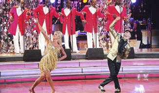 """In this April 23, 2012, photo released by ABC, singer Katherine Jenkins, left, and her partner Mark Ballas perform on the celebrity dance competition series, """"Dancing with the Stars,"""" in Los Angeles. (AP Photo/ABC, Adam Taylor)"""