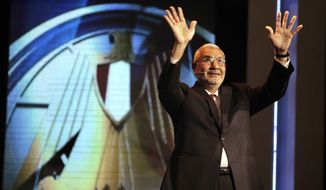"Egyptian presidential candidate, Abdel-Moneim Abolfotoh, waves to his supporters in front of Egyptian presidency logo "" falcon"" during television interview at MISR University for Science and Technology in Cairo, Egypt, Sunday, May 20, 2012. (AP Photo/Amr Nabil)"