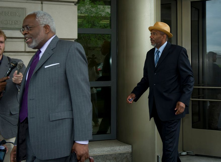 Following his attorney Frederick D. Cooke, Jr., (left) Thomas Gore, a campaign treasurer for Mayor Vincent C. Gray, makes his exit from the E. Barrett Prettyman Federal Courthouse after his plea hearing in the District on Tuesday, May 22, 2012. (Rod Lamkey Jr/The Washington Times)
