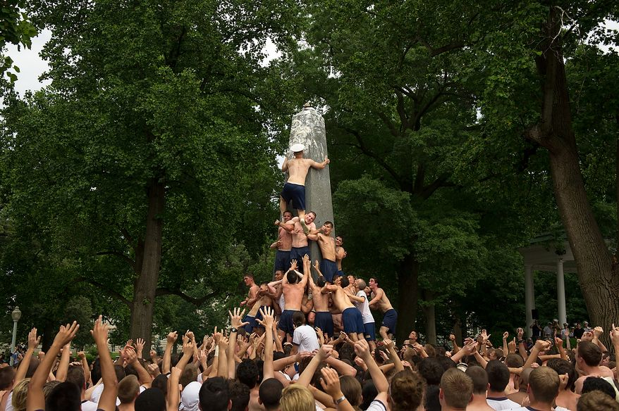 Naval Academy first year plebes participate in the traditional Herndon Monument climb, Annapolis, Md., Tuesday, May 22, 2012. The (Andrew Harnik/The Washington Times)