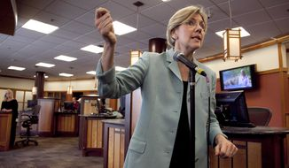 **FILE** Massachusetts Senate candidate Elizabeth Warren responds May 2, 2012, to questions from reporters on her Native American heritage during a news conference at Liberty Bay Credit Union headquarters in Braintree, Mass. (Associated Press)
