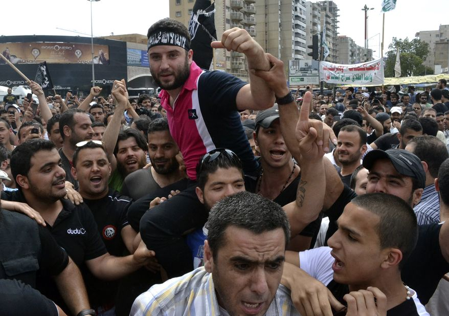 Lebanese anti-Syrian regime critic Shadi Mawlawi (center), who was accused of belonging to a terrorist group, is carried May 22, 2012, on his friends' shoulders in the northern port city of Tripoli, Lebanon, as they celebrate his release from jail. (Associated Press)