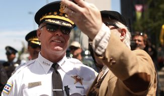 ** FILE ** Chicago police Superintendent Garry McCarthy (left) poses for a photo after protesters marched to President Obama's campaign headquarters in Chicago on Monday, May 21, 2012, the final day of the NATO summit. (AP Photo/Charles Rex Arbogast)
