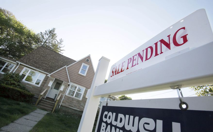 A real estate sign advertises a pending residential sale in Framingham, Mass., on Thursday, April 26, 2012. (AP Photo/Bill Sikes)