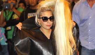 **FILE** American pop singer and songwriter Lady Gaga poses May 19, 2012, before the media upon her arrival in a hotel in Manila's financial district of Makati, Philippines. (Associated Press)