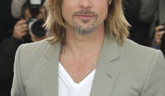 """Actor Brad Pitt poses during a photo call for """"Killing Them Softly"""" at the 65th international film festival, in Cannes, southern France, Tuesday, May 22, 2012. (AP Photo/Joel Ryan)"""