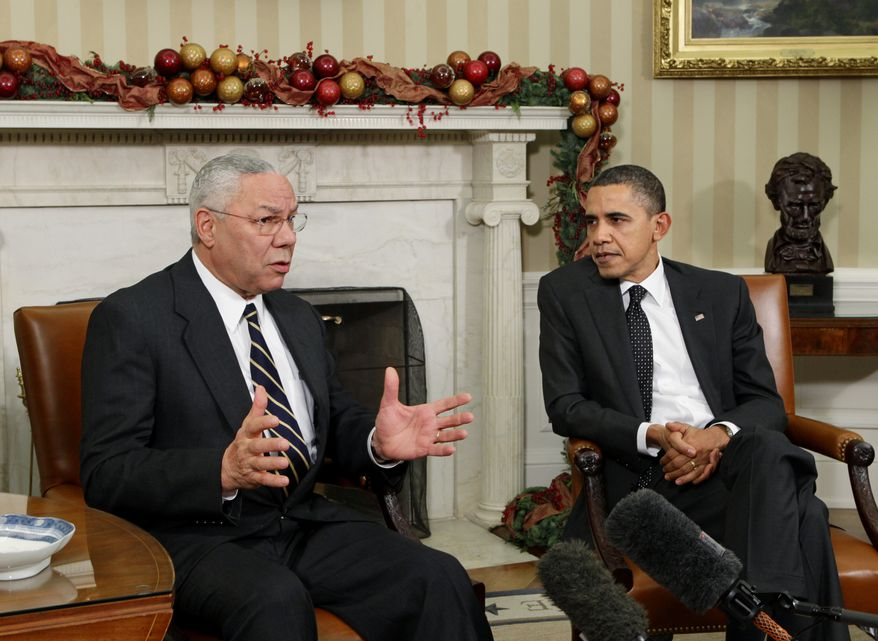 ** FILE ** Colin Powell, a secretary of state in the George W. Bush administration and a former chairman of the Joint Chiefs of Staff, meets with President Obama in the Oval Office at the White House in Washington in December 2010. (AP Photo/J. Scott Applewhite)