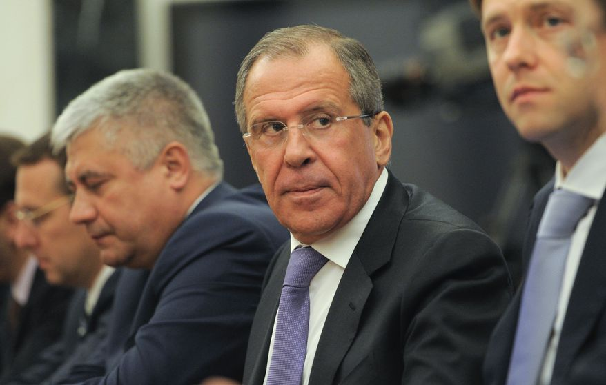 Among the members of Russian President Vladimir Putin's new Cabinet are (from right) Industry and Trade Minister Denis Manturov, Foreign Minister Sergei Lavrov and Interior Minister Vladimir Kolokoltsev, shown attending a Cabinet meeting in the Kremlin in Moscow on Monday, May 21, 2012. (AP Photo/RIA-Novosti, Alexei Druzhinin, Government Press Service)