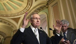 **FILE** Senate Majority Leader Harry Reid, Nevada Democrat, speaks to reporters at the Capitol following a political strategy meeting in Washington on May 22, 2012. (Associated Press)