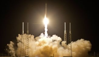 The Falcon 9 SpaceX rocket lifts off from Space Launch Complex 40 at the Cape Canaveral Air Force Station in Cape Canaveral, Fla., early Tuesday, May 22, 2012. The launch marked the first time a private company has sent its own rocket to deliver supplies to the International Space Station. (AP Photo/John Raoux)