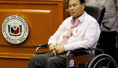 Philippine Supreme Court Chief Justice Renato Corona sits in a wheelchair after being forced back to court after abruptly leaving the witness stand without the permission of the Senate judges during his impeachment trial at the Senate in Manila on Tuesday. Mr. Corona denied that he stole from the country's coffers and said he would open his bank accounts for inspection if the 188 lawmakers who voted to impeach him do the same. (Associated Press)