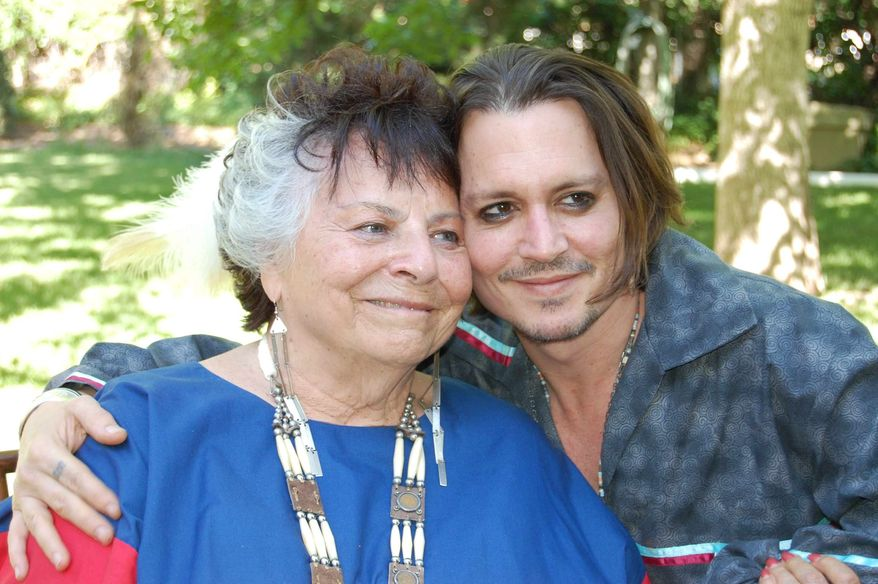 """LaDonna Harris, president of Americans for Indian Opportunity, is joined by actor Johnny Depp at her Albuquerque, N.M., home earlier this month. Ms. Harris invited Mr. Depp to become an adopted member of the Comanche Indian tribe in a private ceremony. Mr. Depp is currently filming the role of Tonto in """"The Long Ranger"""" in New Mexico. (Associated Press)"""