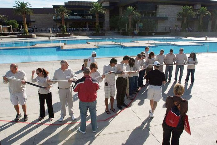 A snapshot posted on an internal GSA website shows attendees at the four-day, $823,000 2010 Western Regions conference in Las Vegas participating in a poolside activity.