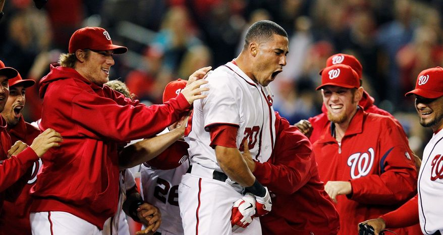 Ian Desmond was greeted by teammates after belting a game-winning, two-run homer against Arizona at Nationals Park on May 2. Desmond's eight home runs lead all NL shortstops. (Associated Press)