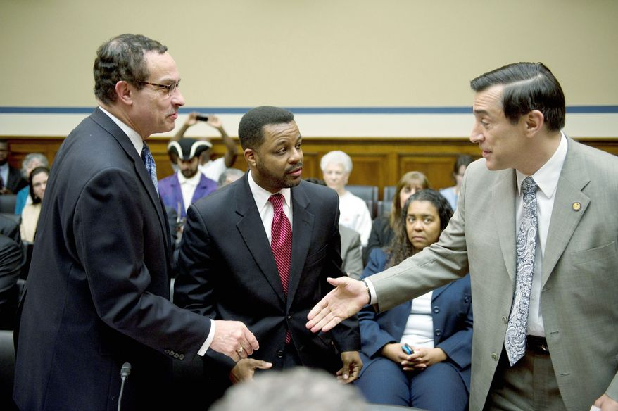 Rep. Darrell E. Issa (right) greets D.C. Mayor Vincent C. Gray (left) and D.C. Council Chairman Kwame R. Brown on Capitol Hill earlier this month. Mr. Gray is seeking authority to set the city's budget year and spend local funds without Congress' prior OK. (Rod Lamkey Jr./The Washington Times)