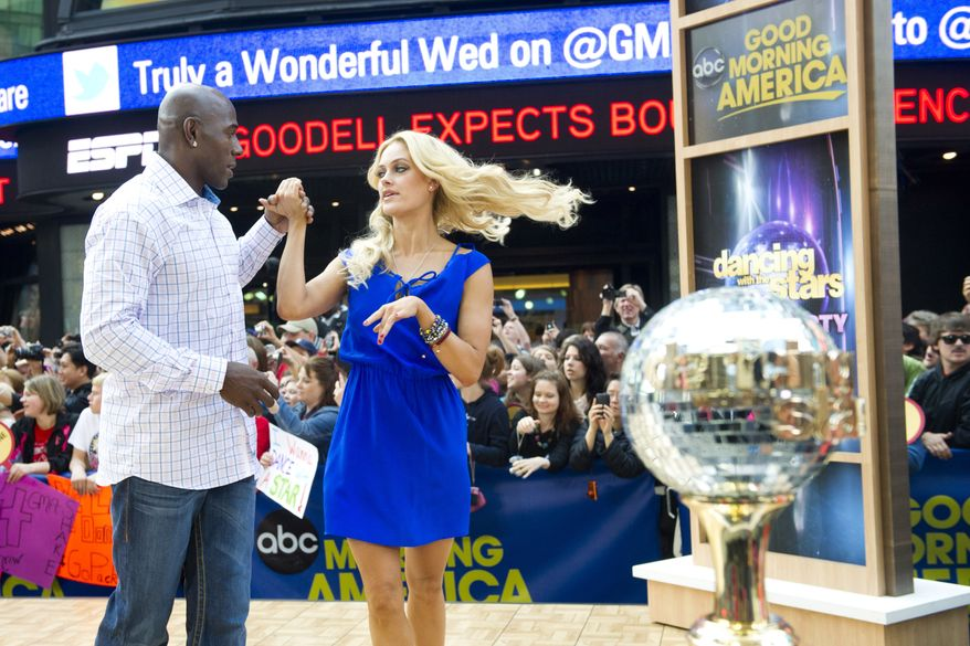 """""""Dancing With The Stars"""" winners Donald Driver and Peta Murgatroyd dance on ABC's """"Good Morning America"""" show, in New York, Wednesday, May 23, 2012. (AP Photo/Charles Sykes)"""