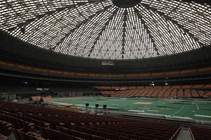 """Once touted as the """"Eighth Wonder of the World,"""" the Astrodome gathers dust on Monday, May 21, 2012, in Houston. (AP Photo/Pat Sullivan)"""