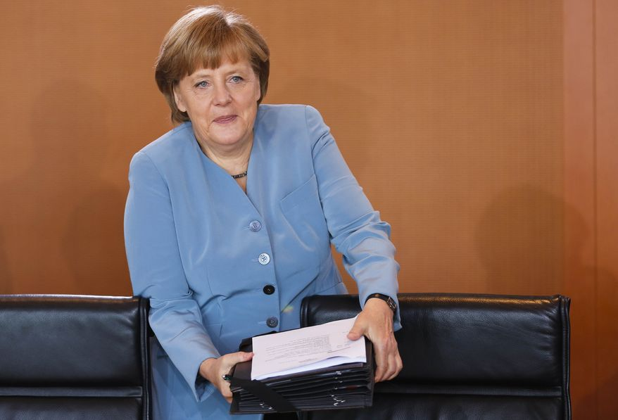 German Chancellor Angela Merkel arrives May 23, 2012, at the weekly cabinet meeting at the chancellery in Berlin. (Associated Press)