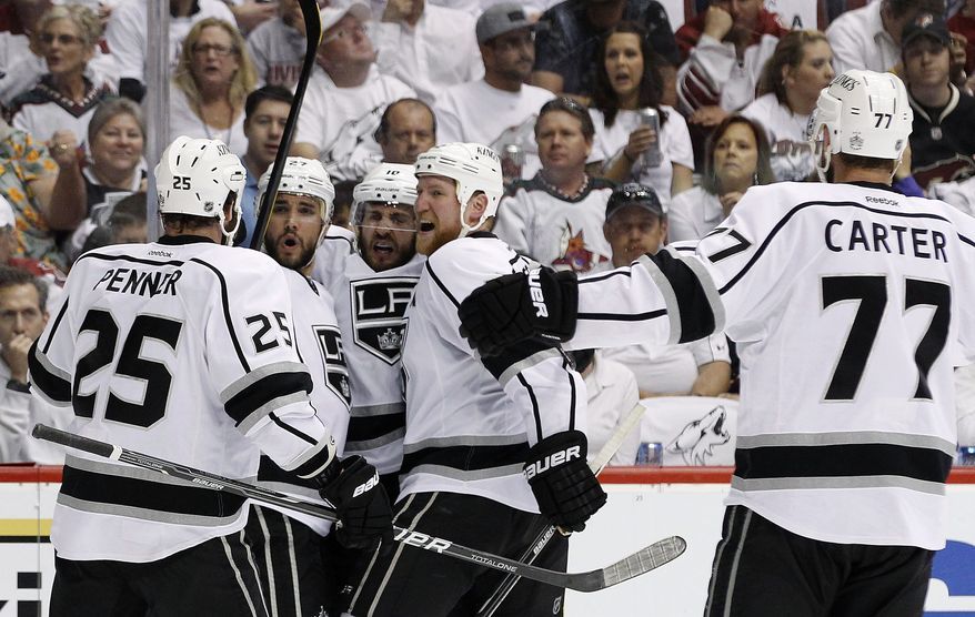 Los Angeles Kings' Mike Richards (10) celebrates his goal against the Phoenix Coyotes with Dustin Penner (25), Alec Martinez (27), Matt Greene and Jeff Carter (77) in the second period during Game 5 of the Western Conference finals, Tuesday, May 22, 2012, in Glendale, Ariz. (AP Photo/Ross D. Franklin)