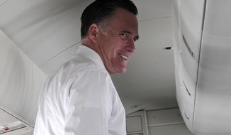 Presumptive Republican presidential nominee Mitt Romney speaks to reporters on a campaign charter flight between New York and Washington on Wednesday, May 23, 2012. (AP Photo/Mary Altaffer)