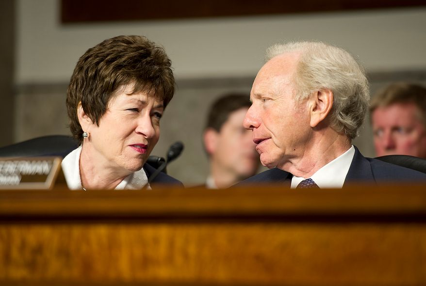 Sens. Susan Collins, left, and Joe Lieberman have a private conversation on the dais during a hearing by the Committee on Homeland Security and Governmental Affairs in which United States Secret Service Director Mark Sullivan testified about the Secret Service scandal in Cartagena in which agents soliticted prostitutes. (Barbara L. Salisbury/The Washington Times)