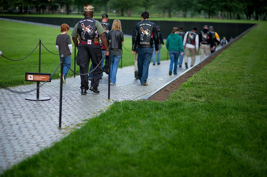 Rolling Thunder's Maryland chapter meets in the early morning on the National Mall to help wash the Vietnam Memorial, Washington, D.C., Sunday, May 13, 2012. (Andrew Harnik/The Washington Times)