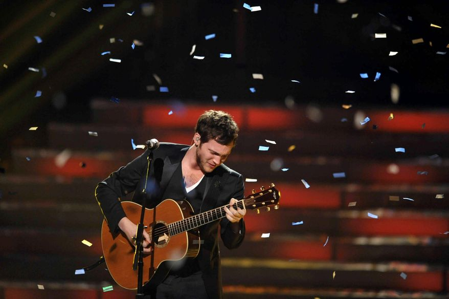 """Phillip Phillips is the fifth male """"American Idol"""" winner in a row after beating Jessica Sanchez on Wednesday. (John Shearer for Invision via Associated Press)"""