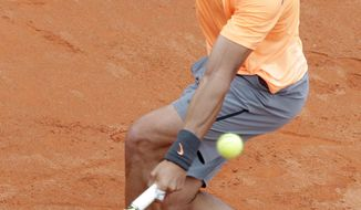 Spain's Rafael Nadal returns the ball to Serbia's Novak Djokovic during their final match at the Italian Open tennis tournament, in Rome, Monday, May 21, 2012. (AP Photo/Riccardo De Luca)
