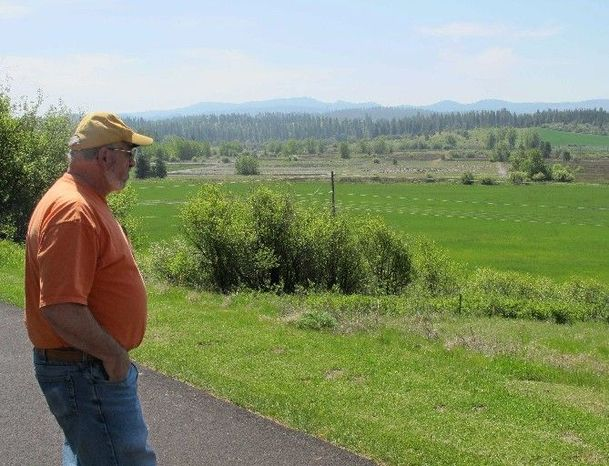 Mayor David Brown checks out a former sawmill site in Potlatch, Idaho. The community was once home to the nation's largest sawmill, and hopes to be revitalized as a gun-making town. Business leaders are actively seeking manufacturers. (Associated Press)