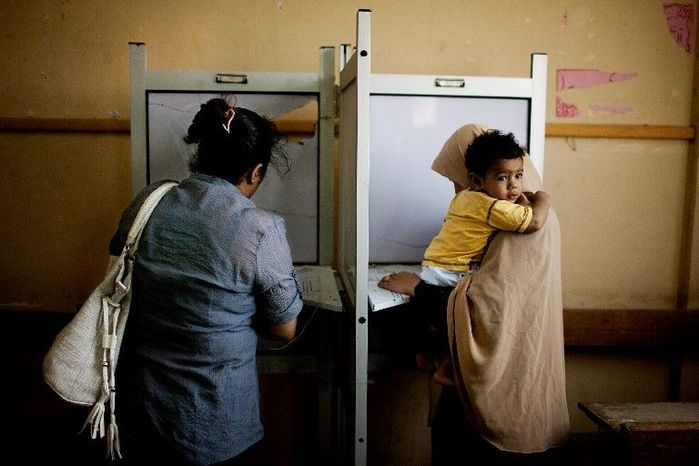 Female Egyptians cast their ballots during the second day of the presidential election in Cairo on Thursday. The voting will produce a successor to longtime authoritarian President Hosni Mubarak. There was no early front-runner.