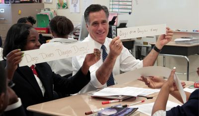 "Republican presidential candidate Mitt Romney and Salina Beattie display work they did together in a sixth grade language arts class during Mr. Romney's visit to Universal Bluford Charter School in West Philadelphia, Pa. His statement that ""just getting smaller classrooms didn't seem to be the key"" to improving education was challenged. (Associated Press)"