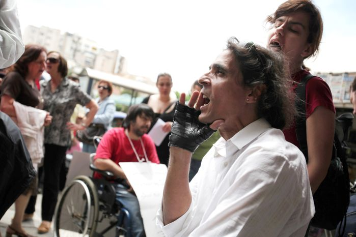 A man in a wheelchair shouts slogans outside the Interior Ministry during a protest Thursday in Athens demanding welfare payments. People with disabilities have not received payments for two months. Greece, which has been mired in a financial crisis for 2 1/2 years, has avoided bankruptcy by receiving loans. (Associated Press)