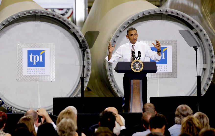 President Obama speaks at the TPI Composites Factory, which manufactures wind-turbine blades, in Newton, Iowa, on Thursday. It is Mr. Obama's second visit as president to Newton, a city of about 15,000 east of Des Moines. (Associated Press)