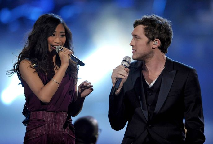"""Runner-up Jessica Sanchez, left, and """"American Idol"""" winner Phillip Phillips perform onstage at the show's finale on Wednesday, May 23, 2012 in Los Angeles. (Photo by John Shearer/Invision/AP)"""