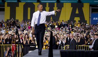 **FILE** President Obama arrives April 25, 2012, to speak at the University of Iowa in Iowa City, Iowa. (Associated Press)