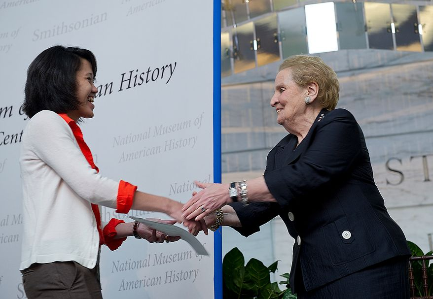Newly naturalized citizen Vy Tuong Nguyen, of Vietnam, shakes hands with former Secretary of State Madeleine Albright after receiving her certificate of citizenship at a naturalization ceremony Thursday, May 24, 2012 at the Smithsonian Institute's National Museum of American History in Washington, D.C. (Barbara L. Salisbury/The Washington Times)