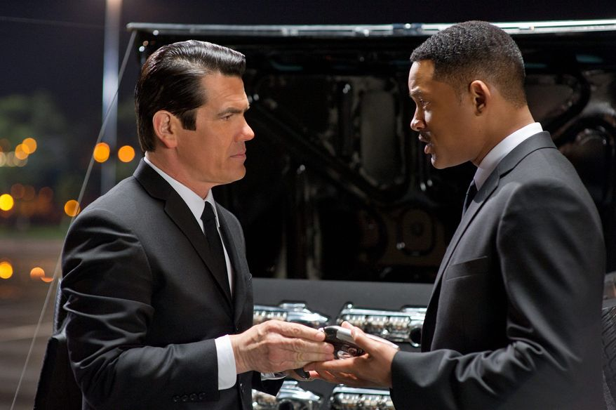 "Josh Brolin (left) and Will Smith star in ""Men in Black 3."" (Associated Press/Columbia Pictures-Sony)"