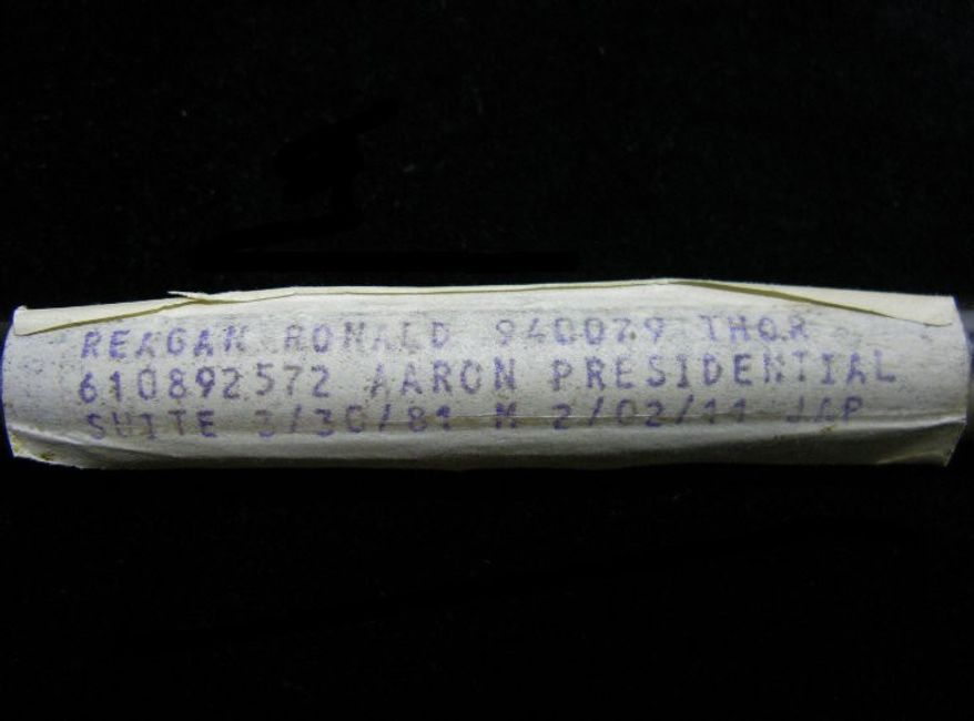 This undated image released by PFCAuctions shows a vial containing President Ronald Reagan's dried blood residue. A Channel Islands online auction house has angered the Reagan Foundation by claiming to offer a vial that once contained his blood. The auctioneers say it was used by the laboratory that tested Reagan's blood when he was hospitalized after a 1981 assassination attempt in Washington. (AP Photo/PFCAuctions)