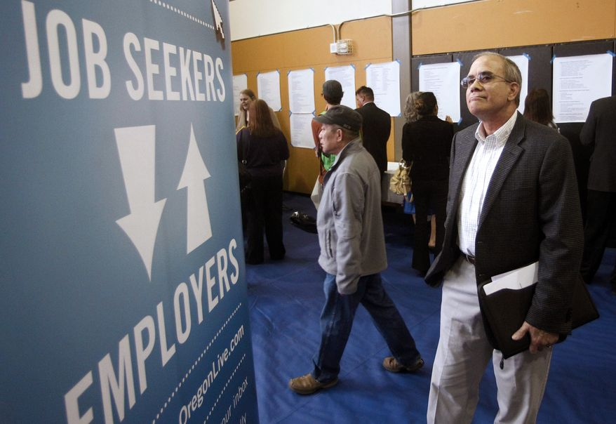 ** FILE ** Job seeker Alan Shull attends an employment fair in Portland, Ore., on Tuesday, April 24, 2012. (AP Photo/Rick Bowmer)