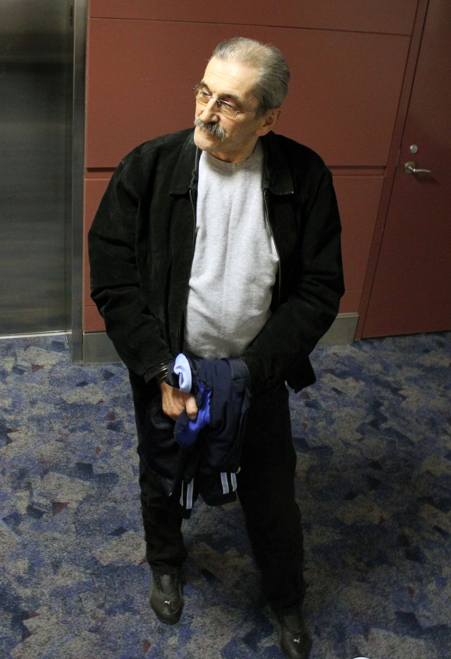 Dejan Radojkovic, a former Bosnian-Serb police commander tied to Srebrenica genocide, arrives at McCarran Airport in Las Vegas for the initial leg of his removal flight back to Sarajevo. The former Bosnian Serb police commander accused of playing a leading role in the 1995 massacre of Bosnian Muslims in Srebrenica has been deported to his native country, U.S. officials said on May 24, 2012. (Associated Press/U.S. Immigration and Customs Enforcement)