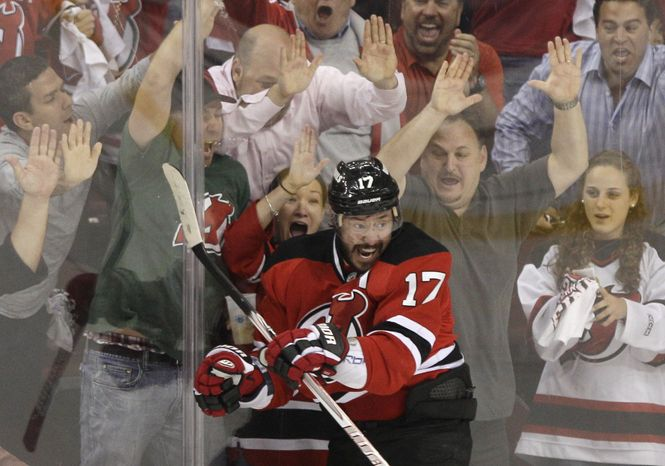 New Jersey Devils' Ilya Kovalchuk celebrates in front of fans after scoring a goal during the first period of Game 6 of the NHL hockey Stanley Cup Eastern Conference finals against the New York Rangers on Friday, May 25, 2012, in Newark, N.J. (AP Photo/Frank Franklin II)