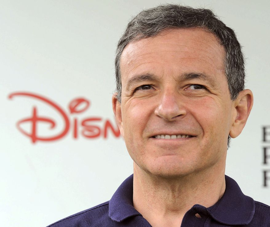 ** FILE ** In this June 12, 2011, file photo, Robert Iger arrives at the 22nd Annual A Time for Heroes Celebrity Carnival, sponsored by Disney at Wadsworth Theater in Los Angeles. Iger is one of the top 10 highest paid CEOs at publicly held companies in America last year, according to calculations by Equilar, an executive compensation data firm, and the Associated Press. (AP Photo/Katy Winn, File)