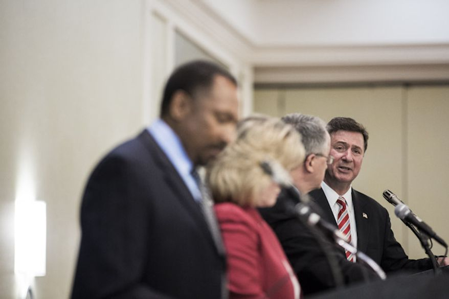 Former senator and governor George Allen, at right, answers a question during the final debate with his three rivals in the Virginia republican primary, from left, Chesapeake minister E.W. Jackson, tea party activist Jamie Radtke and Virginia State Delegate Robert G. Marshall, at the Fairview Park Marriott in Falls Church, Va., on May 25, 2012. Recent polls give Allen a comfortable lead among likely voters in the primary, which will determine the challenger to former governor Timothy M. Kaine, who is unopposed in the democratic primary.  (T.J. Kirkpatrick/Special to The Washington Times)