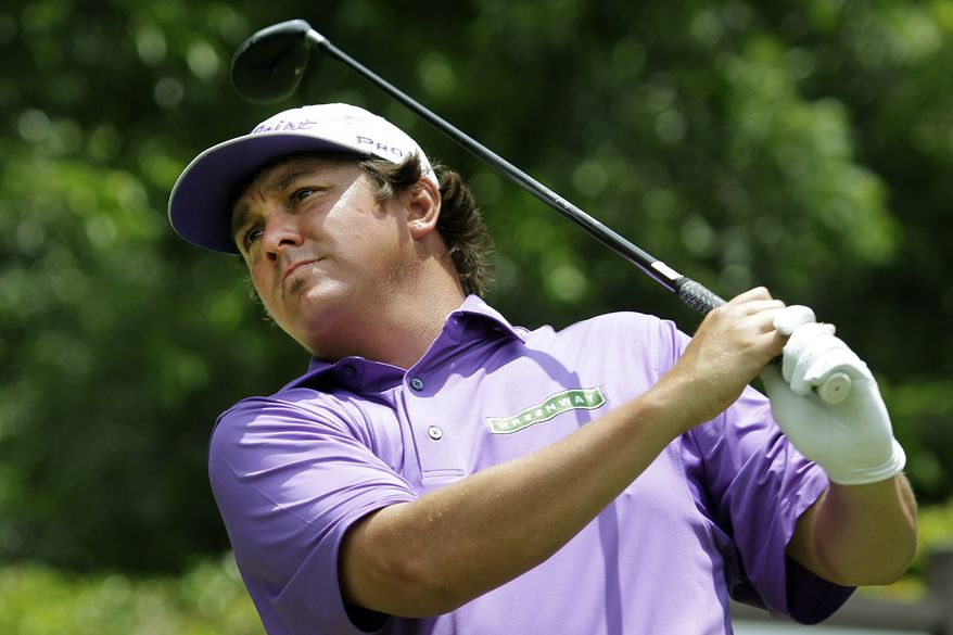 Jason Dufner watches his tee shot on the second hole during the third round of the PGA Colonial tournament, Saturday, May 26, 2012, in Fort Worth, Texas. (AP Photo/LM Otero)