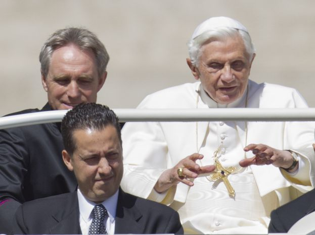 ** FILE ** Pope Benedict XVI, accompanied by his private secretary, Monsignor Georg Gaenswein (top left), and his butler, Paolo Gabriele, arrives in St. Peter's Square at the Vatican for a general audience on Wednesday, May 23, 2012.  (AP Photo/Andrew Medichini)