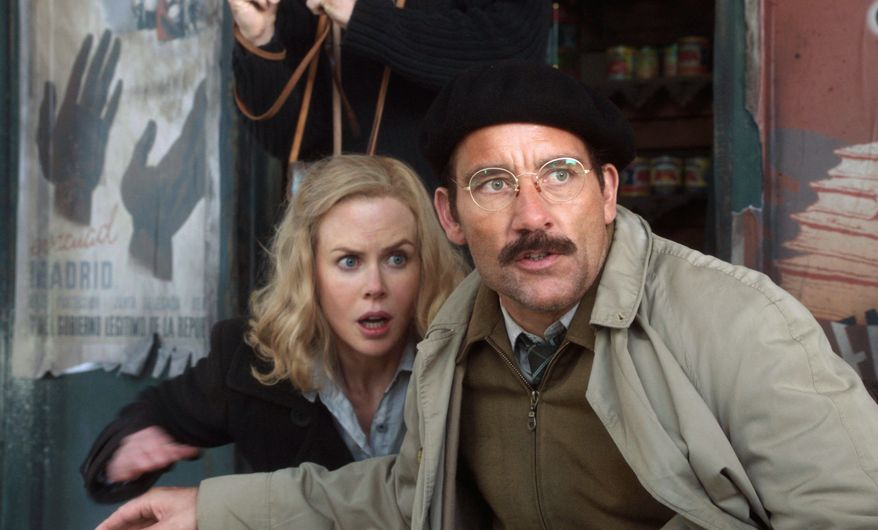 """Nicole Kidman and Clive Owen appear in a scene from the HBO film, """"Hemingway & Gellhorn."""" The film focuses on the relationship between Ernest Hemingway and Martha Gellhorn. Nicole Kidman dedicated her performance to a reporter for Britain's Sunday Times who was killed this year in Syria. (Associated Press)"""